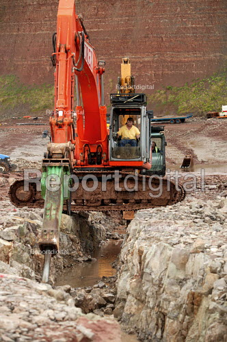 A sewage outlet pipe is cut through rock on the Severn estuary near the Severn bridge crossing. - Paul Box - 2004-08-02