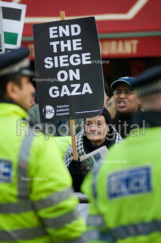 Demonstration outside the Israeli Embassy in South Kensington, London, called by the Palestine Solidarity Campaign, Stop the War Coalition, British Muslim Initiative and other organisations, to protest at the Israeli bombardment of the Gaza strip. - Philip Wolmuth - 2008-12-30