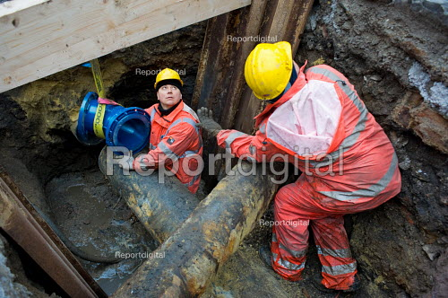 Workers employed by La Cile, a publicly owned water company, replace pipes under a road in a trench, the centre of Liege, Belgium. - Philip Wolmuth - 2009-03-05