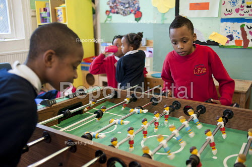 Playing table football After-school club at the Winchester Project, Swiss Cottage, which may close due to cuts to Camden Council's funding. - Philip Wolmuth - 2011-03-14