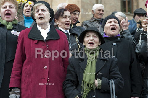 Relatives and friends of the victims of the 1989 Soviet massacre of 20 hunger strikers at a memorial rally outside the Parliament building in Tbilisi, Georgia. - Philip Wolmuth - 2011-04-09