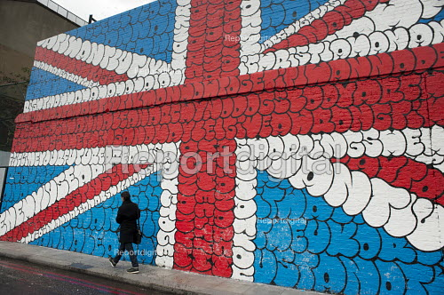 Wall painting of a Union Jack at the Village Underground by Tilt. The bubble letters are the lyrics of Sex Pistols Anarchy in the UK. A renovated warehouse which also houses creative studios, a non-profit gallery and club space in Shoreditch, London, a run-down commercial district also known as Silicon Roundabout, which is undergoing gentrification as it becomes a centre for web-based companies and IT start-ups. - Philip Wolmuth - 2012-01-10
