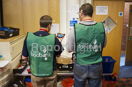 Volunteers preparing an order in the storeroom of Hammersmith & Fulham foodbank. The Trussell Trust, a Christian charity, London - Philip Wolmuth - 2012-08-31