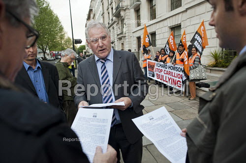 GMB Southern Region Secretary Paul Maloney talks to construction company executives arriving at an awards event at the Royal Institute of British Architecture, London. Ancillary workers from the Great Western Hospital in Swindon, built and managed by Carillion, protest at bullying and blacklisting by the company. Richard Howson is Carillion CEO. - Philip Wolmuth - 2013-05-16