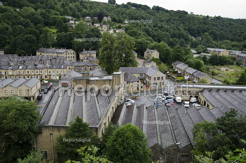 Ex-industrial buildings and housing in Hebden Bridge, West Yorkshire. The town used to be a centre for the wool trade, weaving and clothing manufacture, but is now reliant on tourism, with many residents finding employment in larger towns and cities nearby - Philip Wolmuth - 2013-08-09