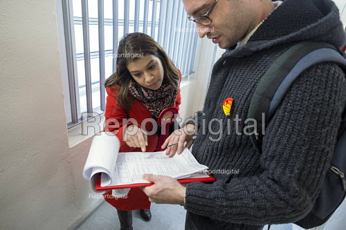 General election 2015: Tulip Siddiq, Labour candidate for Hampstead & Kilburn, the second most marginal seat in the UK, checking a list of voters during a canvassing session in a social housing block in Swiss Cottage, London. - Philip Wolmuth - 2015-03-28