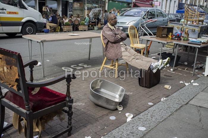 Stallholder in Golborne Road, the downmarket end of Portobello Road street market, London. - Philip Wolmuth - 2015-04-10