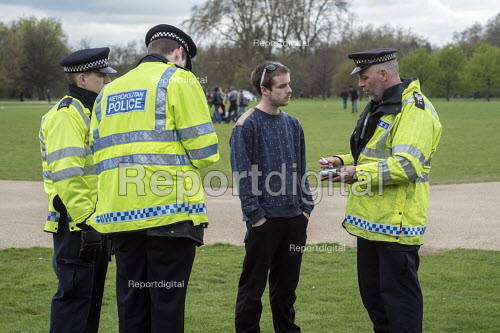 Police cautioning a user. Anyone found in possession of drugs faces arrest and prosecution. Legalise Legalise Cannabis Day, an annual 4/20 event in the campaign to legalise use rather than prohibition. Hyde Park, London. - Philip Wolmuth - 2015-04-19