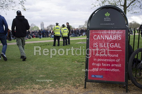 Police sign warning that Cannabis is illegal. Anyone found in possession of drugs faces arrest and prosecution. Legalise Cannabis Day, an annual 4/20 event in the campaign to legalise use rather than prohibition. Hyde Park, London. - Philip Wolmuth - 2015-04-19