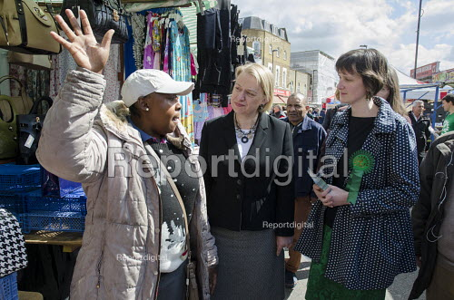 Charlotte George, Green Party parliamentary candidate for Hackney South and Shoreditch, with party leader Natalie Bennett, Ridley Road market, Dalston, London. - Philip Wolmuth - 2015-04-30