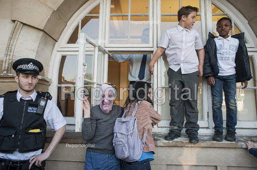 Blue 9 private security guards prevent protesters from entering Hendon Town Hall through a window. Tenants, evicted tenants and housing campaigners in Barnet, north London, protest over the sale of West Hendon estate and the demolition of Sweets Way estate. - Philip Wolmuth - 2015-05-13