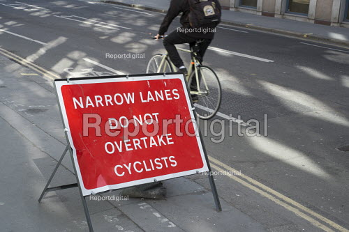 Narrow lanes do not overtake cyclists. Temporary warning sign on a road in central London. 14 cyclists were killed in road accidents in London in 2014. - Philip Wolmuth - 2015-05-12