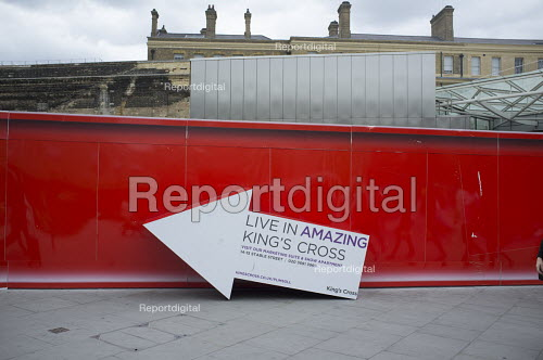 Sign pointing to marketing suite Kings Cross development site London - Philip Wolmuth - 2015-08-05