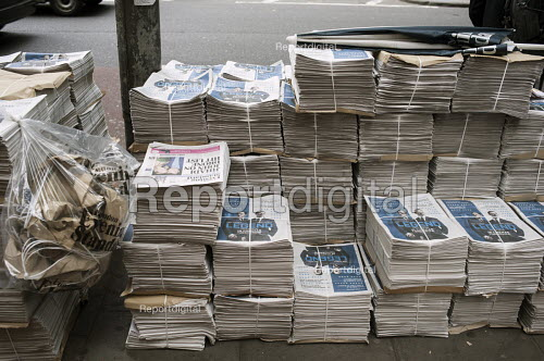 Evening Standard stacked on the street for distribution at Holborn station London - Philip Wolmuth - 2015-09-08