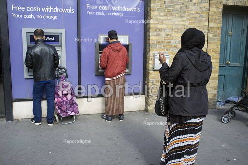 NatWest ATM in Whitechapel London, which has the largest Muslim community in the UK - Philip Wolmuth - 2015-09-23