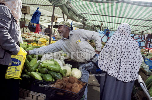 Market trader. Whitechapel market serves the largest Muslim community in the UK, East London - Philip Wolmuth - 2015-09-23