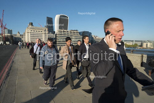 City of London workers cross London Bridge at the start of the evening rush hour - Philip Wolmuth - 2015-09-30