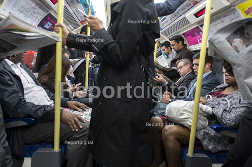 Crowded rush hour tube train carriage on the London underground - Philip Wolmuth - 2015-09-30