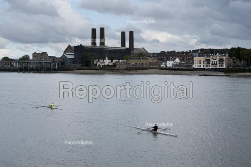 Canoeists on the river Thames London rowing past Greenwich Power Station - Philip Wolmuth - 2015-10-06