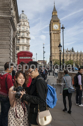 Tourists with camera by red phone box and Big Ben London Parliament Square - Philip Wolmuth - 2015-09-29