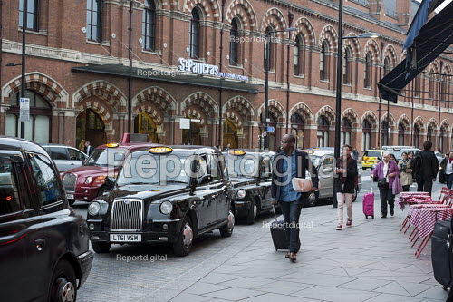 Black cab taxis queue for passengers at a taxi rank, St Pancras station London - Philip Wolmuth - 2015-10-16