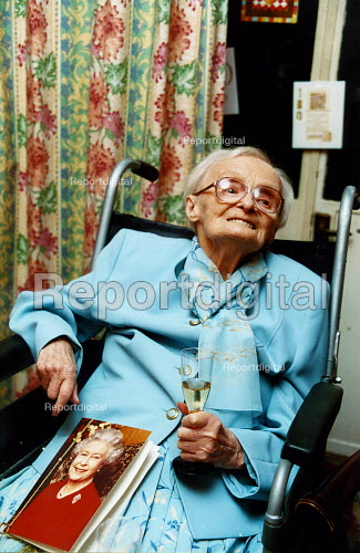 Elderly woman celebrates her 100th birthday, has a card from the Queen, Haringay , North London - Joanne O'Brien - 2003-02-06