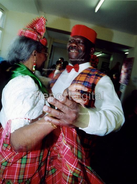 Elderly people dancing Domincan Quadrille at community centre in Haringey, North London - Joanne O'Brien - 20021024