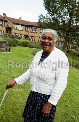 Elderly woman in grounds of sheltered accommodation London - Joanne O'Brien - 20021024