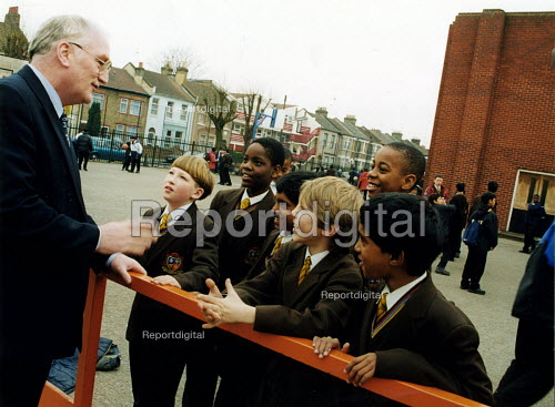 Headmaster talking to pupils in playground, East London - Joanne O'Brien - 20021024