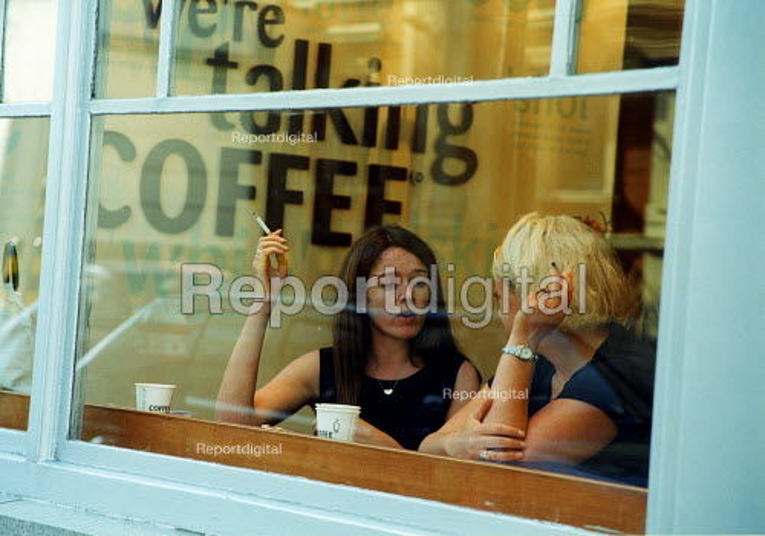 Two women smoking in cafe, Smithfield London - Joanne O'Brien - 20021024