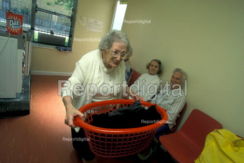 Elderly woman doing laundry at residential home - Joanne O'Brien - 20021024