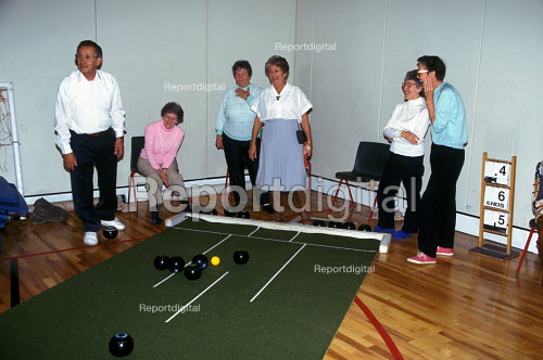 Elderly people play bowling at leisure centre Hackney - Joanne O'Brien - 20021024
