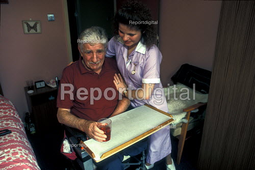 Elderly man with carer in residential home - Joanne O'Brien - 20021024