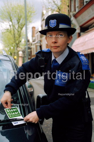 PSCO Caorol Phillips, one of 11 new Police Community Support Officer. She is placing a card warning how to avoid car crime on a vehicle with a bag left lying in full view on the back seat. - Joanne O'Brien - 2003-05-02