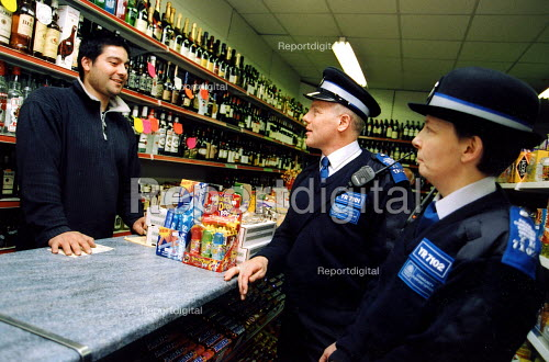 PSCO David Wylie & PSCO Carol Phillips chatting to local shopkeeper Serdar Simsik . They are some of the 11 new Police Community Support Officers. - Joanne O'Brien - 2003-05-02