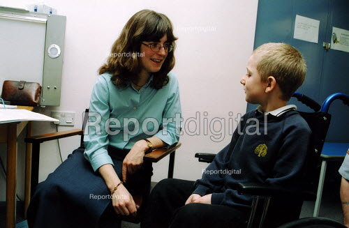Boy with muscular dystrophy at Guy's Hospital with doctor - Joanne O'Brien - 20021024