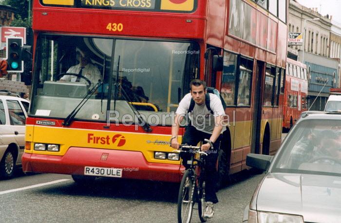 Cyclist and bus, London. - Joanne O'Brien - 20021024