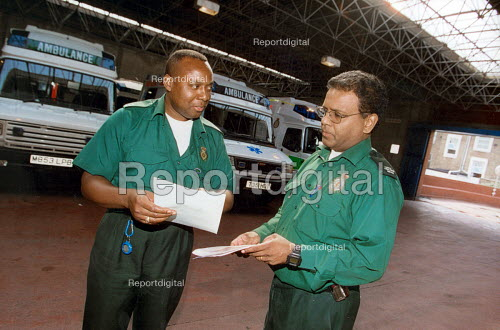 Ambulance crew with details of a 'shout' before setting off Campden London - Joanne O'Brien - 20021024