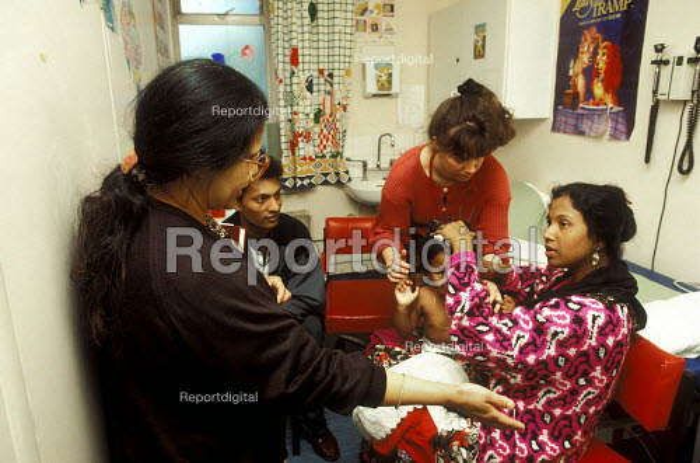 Bengali interpreter (left) working at hospital in East London - Joanne O'Brien - 20021024