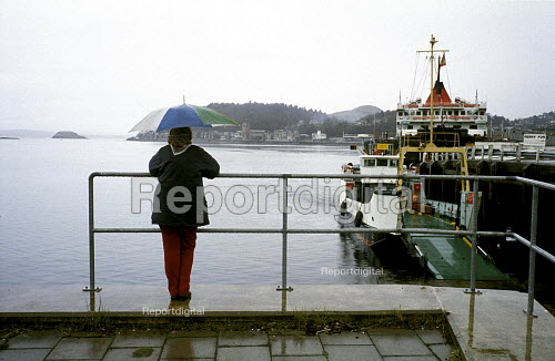 Woman with Umbrella Watching the Western Isles Ferries on a Rainy Day, Oban Harbour, Scotland. 1992, ... - Paul Mattsson - 1992-12-28