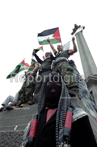 Symbolic suicide bombers at Palestinian demonstration against Israeli occupation - Paul Mattsson - 2002-05-18