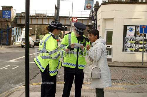 Police officers give directions to woman on the street. London - Joanne O'Brien - 2004-04-24