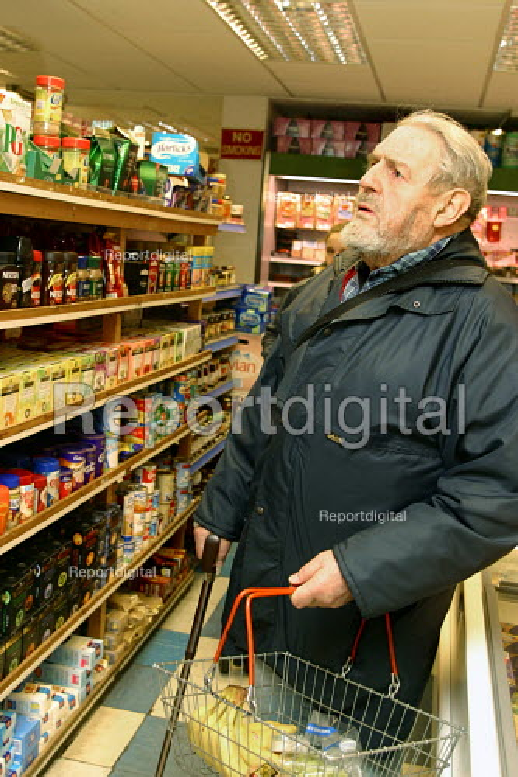 Elderly man shopping in local supermarket. - Joanne O'Brien - 2004-04-24