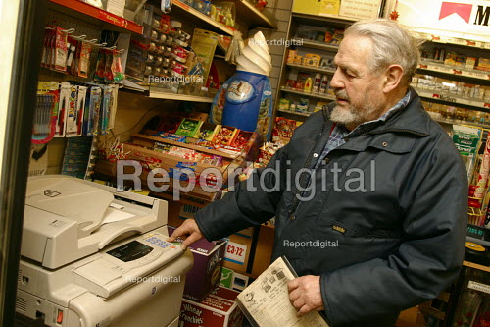 Elderly man using photocopier in local supermarket - Joanne O'Brien - 2004-04-24