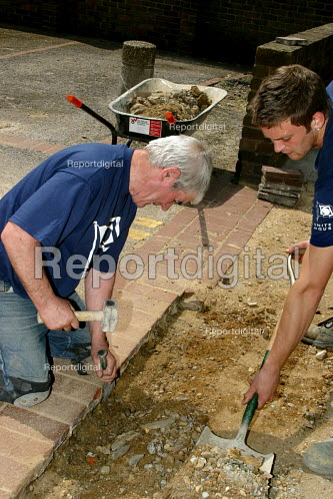 Builders landscaping pavements on housing estate Southwark, London - Joanne O'Brien - 2004-04-24
