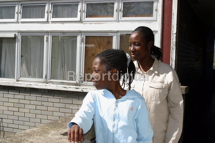 Mother and daughter on Wood Dene estate, Peckham, London - Joanne O'Brien - 2002-10-24