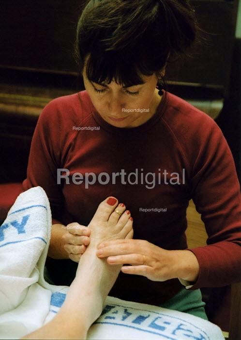A patient receiving Reflexology treatment. - Joanne O'Brien - 20021024