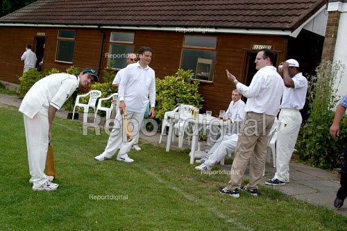 Businessmen playing cricket - Joanne O'Brien - 20021024