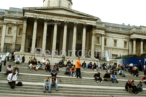 Tourists sitting on the steps of the National Gallery, Trafalgar Square, London - Joanne O'Brien - 20021024