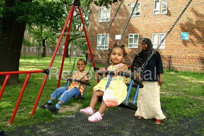 Children play on swings, Kingswood Estate, Southwark, London - Joanne O'Brien - 20021024